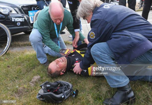 Tom Boonen of Omega PharmaQuick Step and Belgium lies on the ground injured after crashing during the 97th edition of the Tour of Flanders on March...