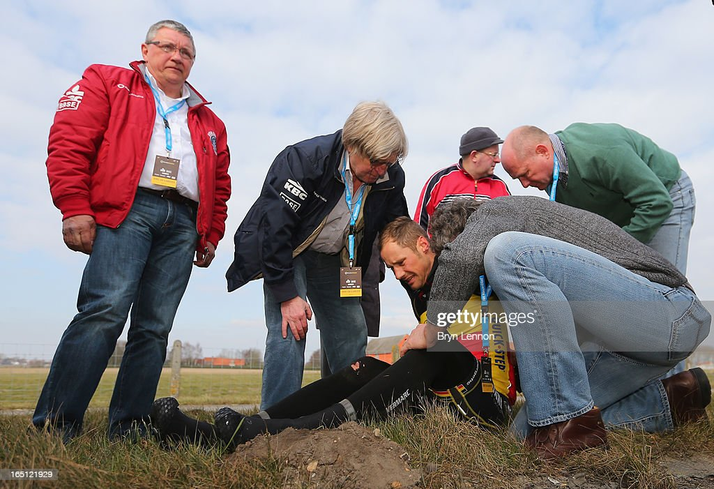 Tom Boonen of Omega Pharma-Quick Step and Belgium lies on the ground injured after crashing during the 97th edition of the Tour of Flanders (Ronde van Vlaanderen) on March 31, 2013 in Brugge, Belgium. Boonen abandoned the race.