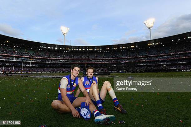 Tom Boyd and Joel Hamling of the Bulldogs take it all in as they rest in the middle of the MCG after winning the 2016 AFL Grand Final match between...