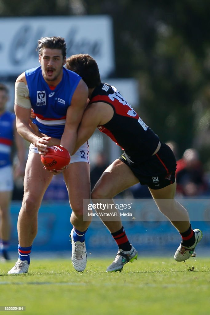 Tom Boyd of Footscray Bulldogs gets tackled by Kyle Langford of Essendon Bombers during the round 18 VFL match between the Essendon Bombers and Footscray Bulldogs at Windy Hill on August 19, 2017 in Melbourne, Australia.
