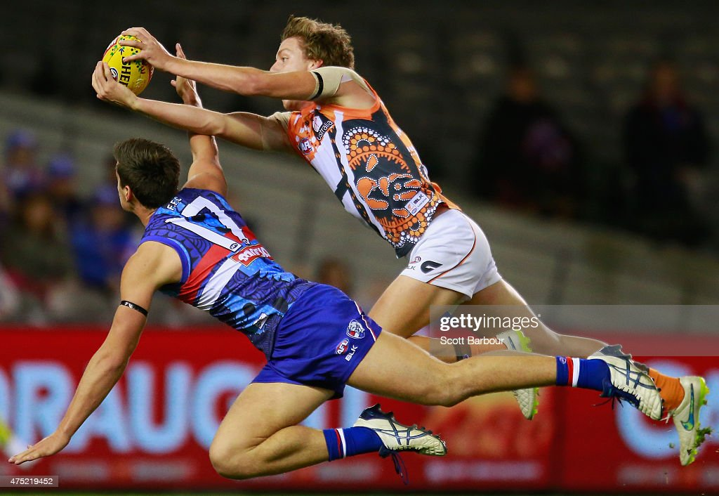 Tom Boyd of the Bulldogs and Aidan Corr of the Giants compete for the ball during the round nine AFL match between the Western Bulldogs and the...