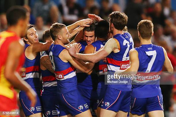 Tom Boyd of the Bulldogs celebrates a goal with teammates during the round 17 AFL match between the Western Bulldogs and the Gold Coast Suns at...