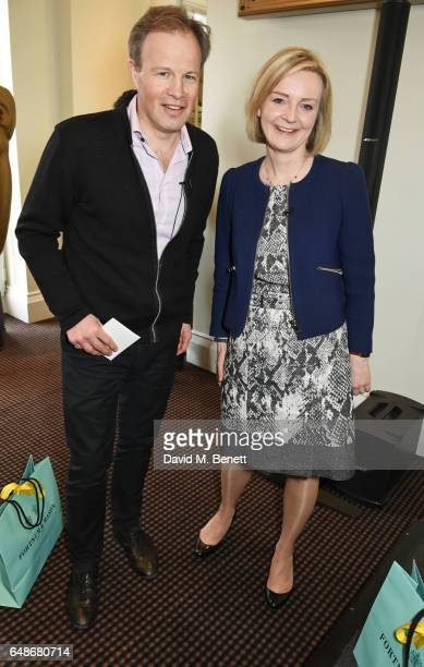Tom Bradby and Elizabeth Truss Lord Chancellor and Secretary of State for Justice attend the 'Turn The Tables' lunch hosted by Tania Bryer and James...