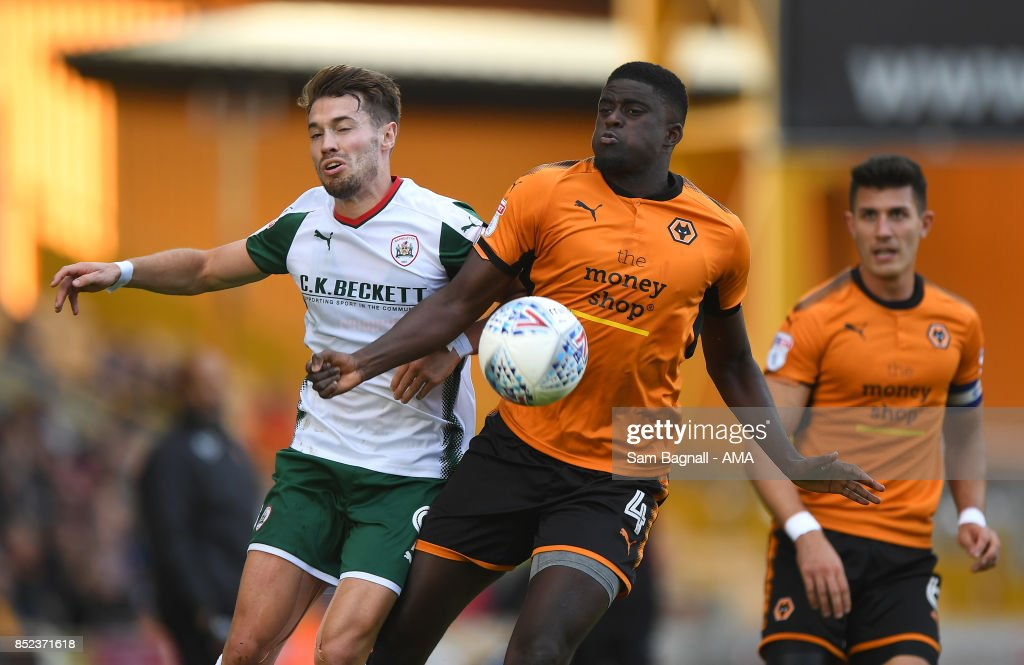 Tom Bradshaw of Barnsley and Alfred NDiaye of Wolverhampton Wanderers during the Sky Bet Championship match between Wolverhampton and Barnsley at Molineux on September 23, 2017 in Wolverhampton, England.