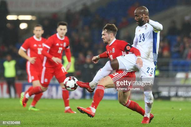 Tom Bradshaw of Wales is challenged by Felipe Baloy of Panama during the International Friendly match between Wales and Panama at The Cardiff City...