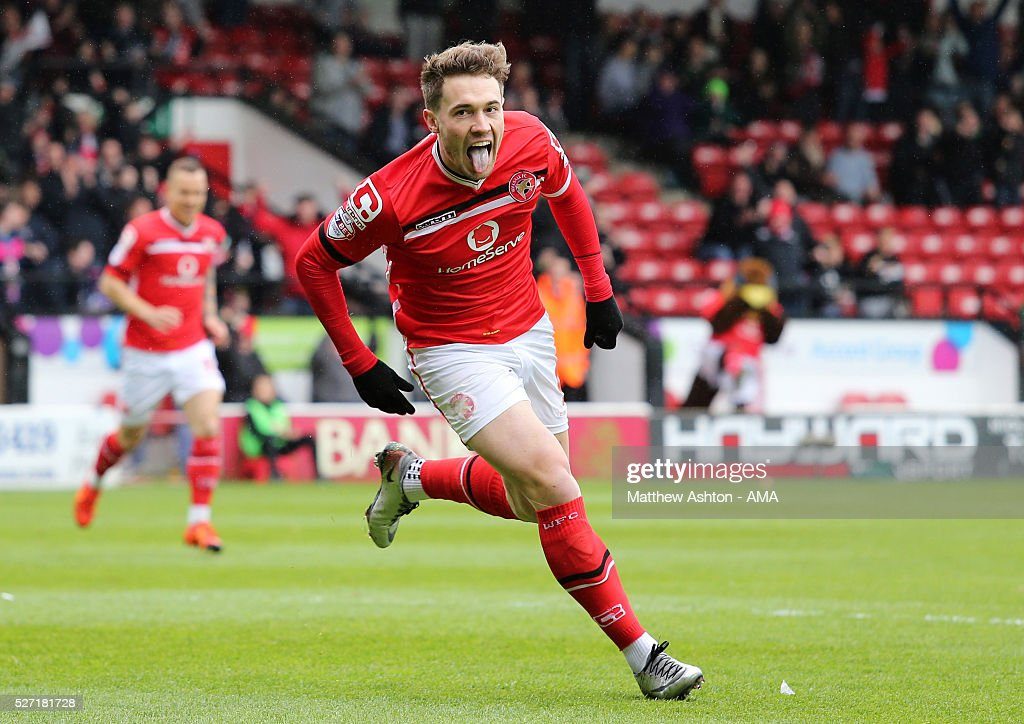 Tom Bradshaw of Walsall celebrates after scoring a goal to make it 1-0 during the Sky Bet League One match between Walsall and Fleetwood Town at Bescot Stadium on May 2, 2016 in Walsall, England.