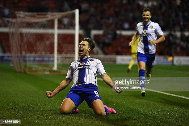 Tom Bradshaw of Walsall celebrates scoring the winning goal during the Capital One Cup First Round match between Nottingham Forest and Walsall at...