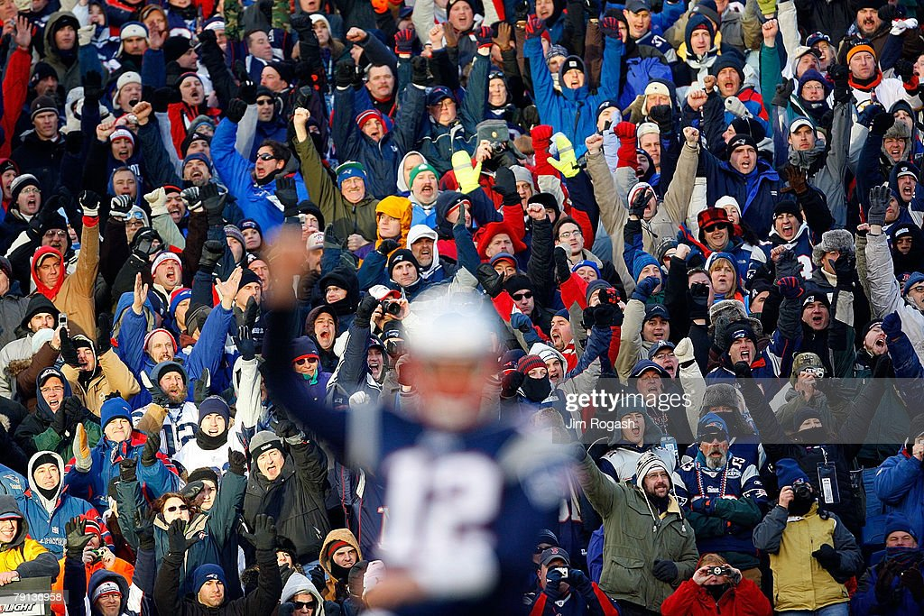 Tom Brady and fans of the New England Patriots celebrate after a touchdown in the second quarter against the San Diego Chargers during the AFC...