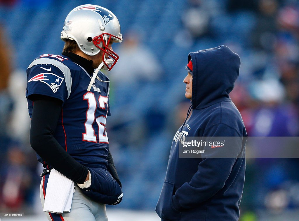 <a gi-track='captionPersonalityLinkClicked' href=/galleries/search?phrase=Tom+Brady+-+American+football-quarterback&family=editorial&specificpeople=201737 ng-click='$event.stopPropagation()'>Tom Brady</a> #12 and head coach <a gi-track='captionPersonalityLinkClicked' href=/galleries/search?phrase=Bill+Belichick&family=editorial&specificpeople=201822 ng-click='$event.stopPropagation()'>Bill Belichick</a> of the New England Patriots talk before the 2014 AFC Divisional Playoffs game against the Baltimore Ravens at Gillette Stadium on January 10, 2015 in Foxboro, Massachusetts.