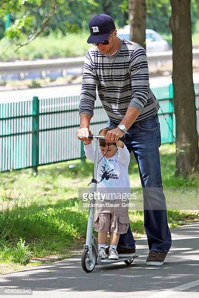 Tom Brady and his son Benjamin Brady are seen riding scooter on June 01 2012 in Boston Massachusetts
