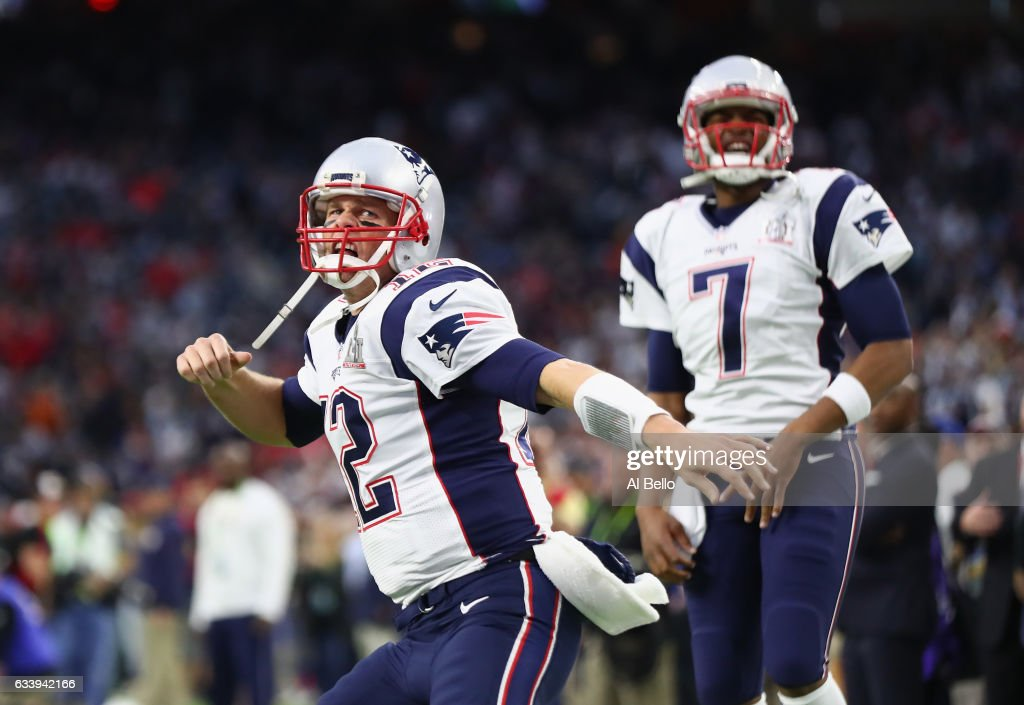 Tom Brady #12 and Jacoby Brissett #7 of the New England Patriots take the field prior to Super Bowl 51 against the Atlanta Falcons at NRG Stadium on February 5, 2017 in Houston, Texas.