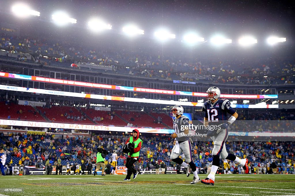 Tom Brady and Jimmy Garoppolo of the New England Patriots take the field before the game against the Pittsburgh Steelers at Gillette Stadium on...