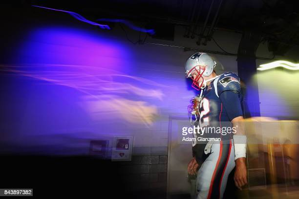 Tom Brady and Jimmy Garoppolo of the New England Patriots walks to the field before the game against the Kansas City Chiefs at Gillette Stadium on...