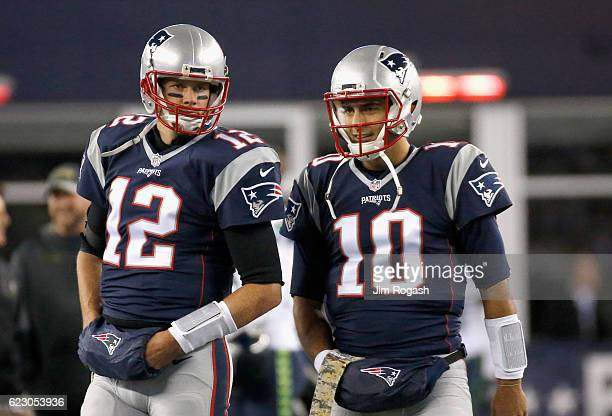 Tom Brady and Jimmy Garoppolo of the New England Patriots warm up before a game against the Seattle Seahawks at Gillette Stadium on November 13 2016...