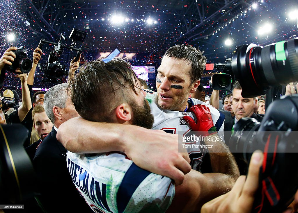 Tom Brady #12 and Julian Edelman #11 of the New England Patriots celebrate after defeating the Seattle Seahawks 28-24 to win Super Bowl XLIX at University of Phoenix Stadium on February 1, 2015 in Glendale, Arizona.