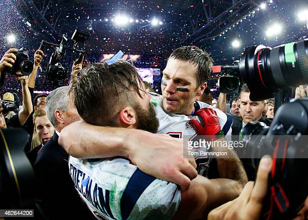 Tom Brady and Julian Edelman of the New England Patriots celebrate after defeating the Seattle Seahawks 2824 to win Super Bowl XLIX at University of...