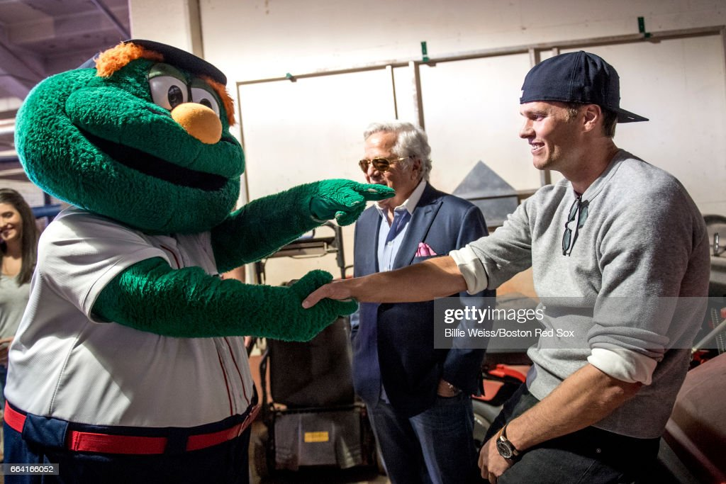 Tom Brady #12 and owner Robert Kraft of the New England Patriots are greeted by Boston Red Sox mascot Wally before a pre-game ceremony before the Boston Red Sox home opener against the Pittsburgh Pirates on April 3, 2017 at Fenway Park in Boston, Massachusetts.