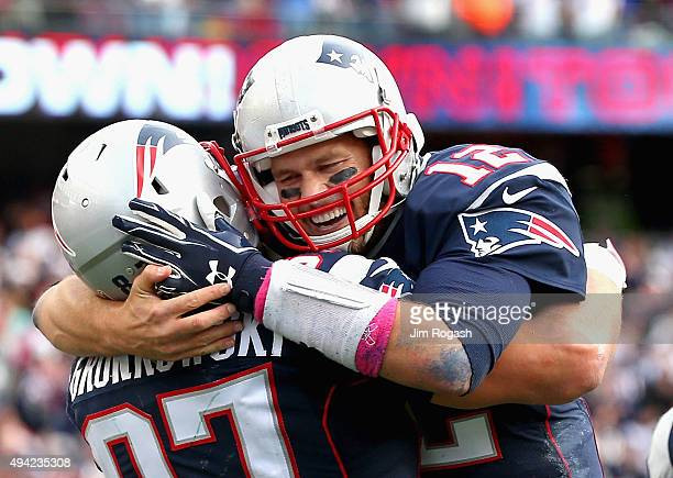 Tom Brady and Rob Gronkowski of the New England Patriots react after Gronkowski scored a touchdown during the fourth quarter against the New York...