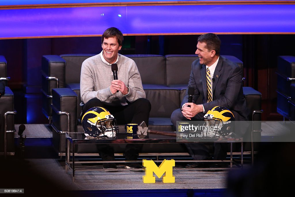 <a gi-track='captionPersonalityLinkClicked' href=/galleries/search?phrase=Tom+Brady+-+American+Football+Quarterback&family=editorial&specificpeople=201737 ng-click='$event.stopPropagation()'>Tom Brady</a>, former Michigan Wolverine and current NFL quarterback talks with Head coach <a gi-track='captionPersonalityLinkClicked' href=/galleries/search?phrase=Jim+Harbaugh&family=editorial&specificpeople=779595 ng-click='$event.stopPropagation()'>Jim Harbaugh</a> of the Michigan Wolverines during the Michigan Signing of the Stars event at Hill Auditorium on February 3, 2016 in Ann Arbor, Michigan.