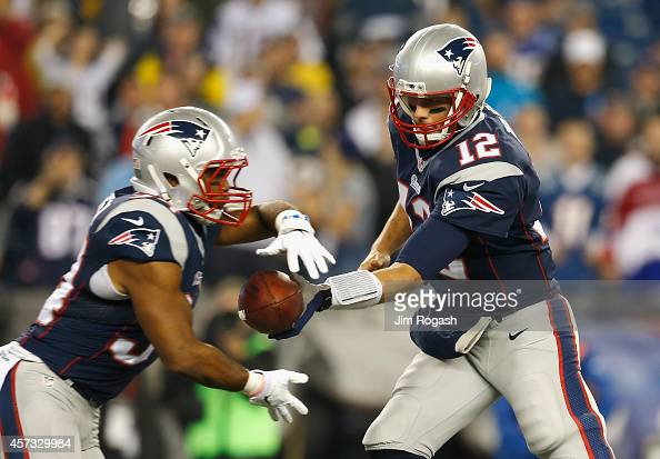 Tom Brady hands off the ball to Shane Vereen of the New England Patriots during the first quarter against the New York Jets at Gillette Stadium on...