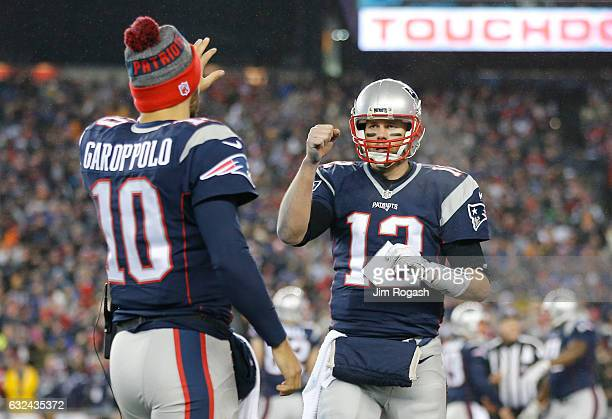 Tom Brady is congratulated by his teammate Jimmy Garoppolo of the New England Patriots after his touchdown against the Pittsburgh Steelers during the...