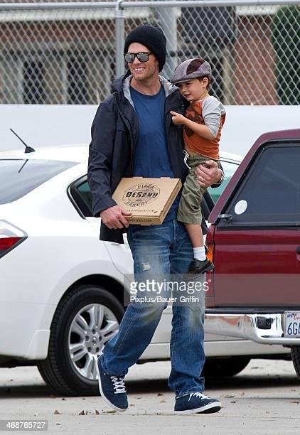 Tom Brady is seen leaving DeSano Pizza with his son Benjamin Rein Bundchen Brady on February 11 2014 in Los Angeles California