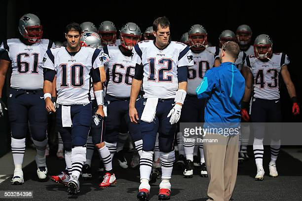 Tom Brady leads the New England Patriots onto the field before the game against the Miami Dolphins at Sun Life Stadium on January 3 2016 in Miami...