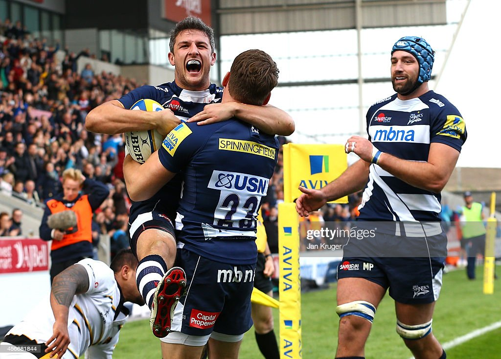 Tom Brady of Sale Sharks celebrates his try with team mate Mark Cueto during the Aviva Premiership match between Sale Sharks and Wasps at AJ Bell Stadium on October 5, 2014 in Salford, England.