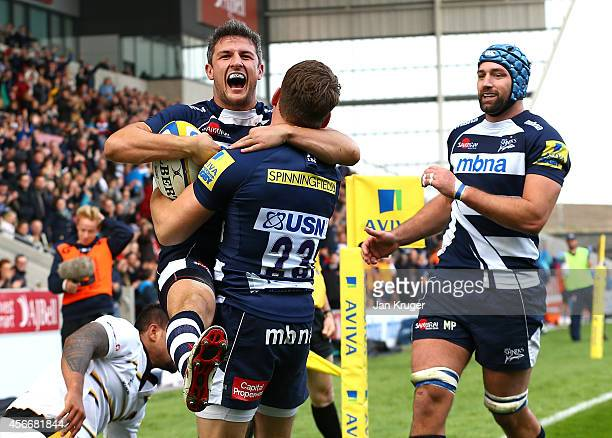 Tom Brady of Sale Sharks celebrates his try with team mate Mark Cueto during the Aviva Premiership match between Sale Sharks and Wasps at AJ Bell...