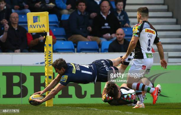 Tom Brady of Sale Sharks dives over the line to score the opening try during the Aviva Premiership match between Sale Sharks and Harlequins at AJ...