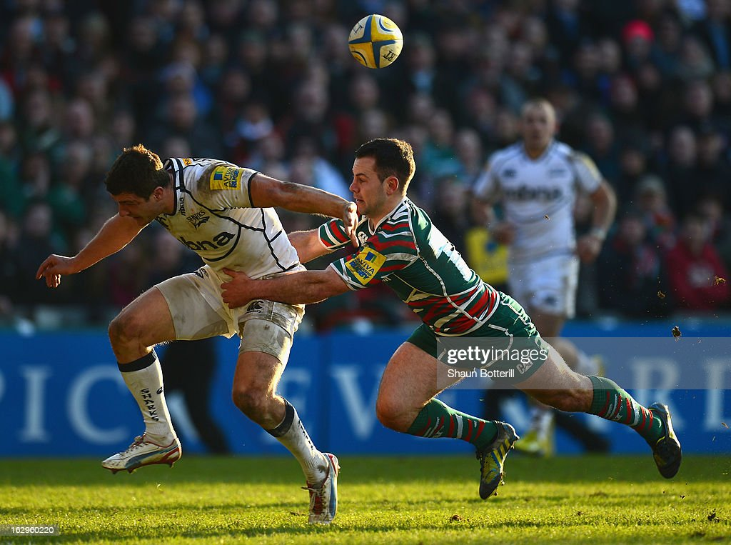 Tom Brady of Sale Sharks is tackled by Micky Young of Leicester Tigers during the Aviva Premiership match between Leicester Tigers and Sale Sharks at Welford Road on March 2, 2013 in Leicester, England.