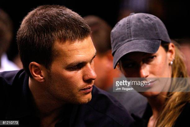 Tom Brady of the New England Patriots and Gisele Bundchen watch as the Detroit Pistons play against the Boston Celtics during Game Two of the 2008...