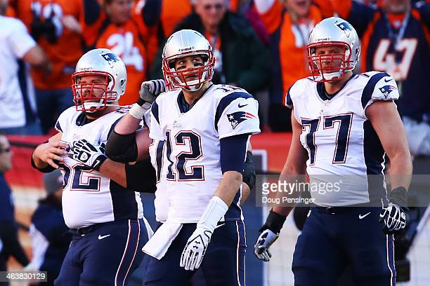Tom Brady of the New England Patriots and his team walk off of the field after a failed twopoint conversion in the fourth quarter against the Denver...