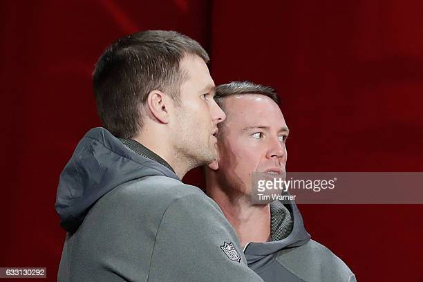 Tom Brady of the New England Patriots and Matt Ryan of the Atlanta Falcons look on during Super Bowl 51 Opening Night at Minute Maid Park on January...