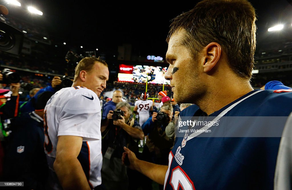 Tom Brady #12 of the New England Patriots and Peyton Manning #18 of the Denver Broncos greet each other at midfield following the game on October 7, 2012 at Gillette Stadium in Foxboro, Massachusetts.