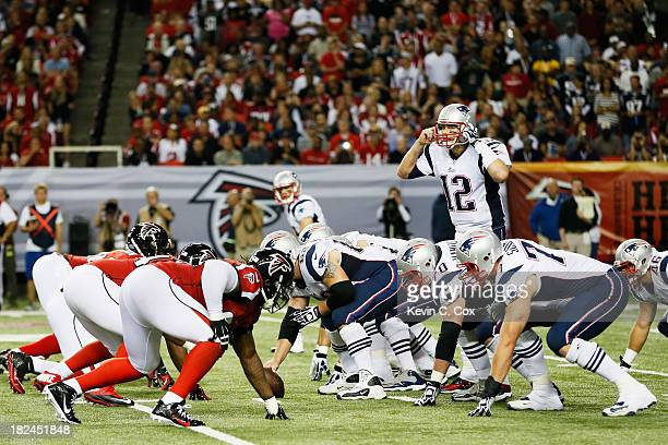 Tom Brady of the New England Patriots calls a play against the Atlanta Falcons during the game at Georgia Dome on September 29 2013 in Atlanta Georgia