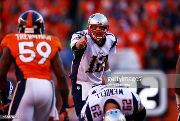 Tom Brady of the New England Patriots calls a play in the fourth quarter against the Denver Broncos during the AFC Championship game at Sports...