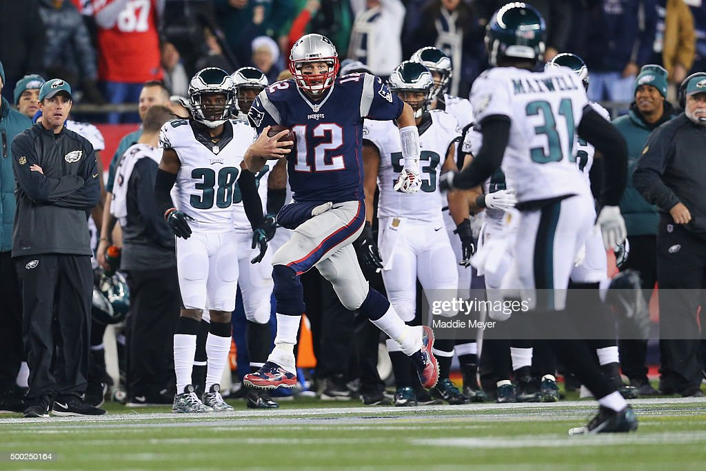 Tom Brady #12 of the New England Patriots carries the ball during the third quarter against the Philadelphia Eagles at Gillette Stadium on December 6, 2015 in Foxboro, Massachusetts.