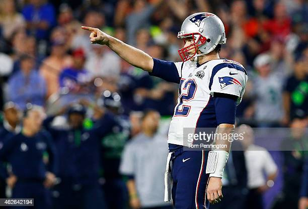 Tom Brady of the New England Patriots celebrates a touchdown against Seattle Seahawks in the fourth quarter during the during Super Bowl XLIX at...