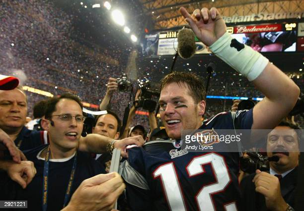 Tom Brady of the New England Patriots celebrates after defeating the Carolina Panthers 3229 in Super Bowl XXXVIII at Reliant Stadium on February 1...