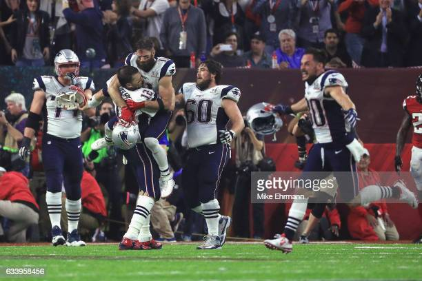 Tom Brady of the New England Patriots celebrates after defeating the Atlanta Falcons 3428 in overtime during Super Bowl 51 at NRG Stadium on February...