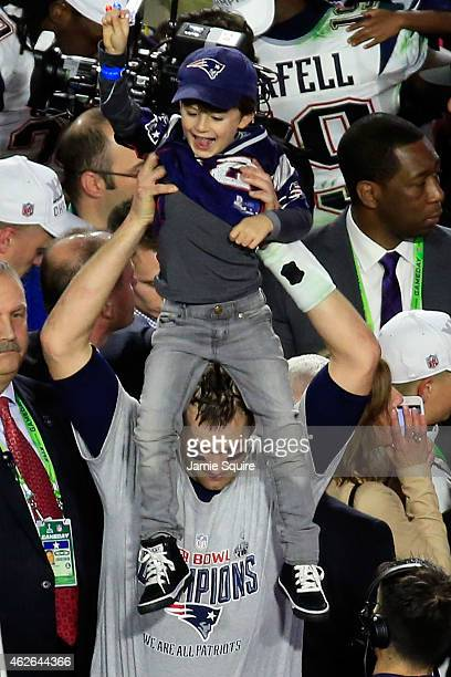 Tom Brady of the New England Patriots celebrates defeating the Seattle Seahawks with his son Benjamin during Super Bowl XLIX at University of Phoenix...