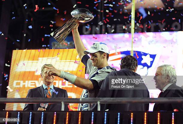Tom Brady of the New England Patriots celebrates holding up the Vince Lombardi Trophy after the Patriots defeated the Seattle Seahawks 2824 in Super...