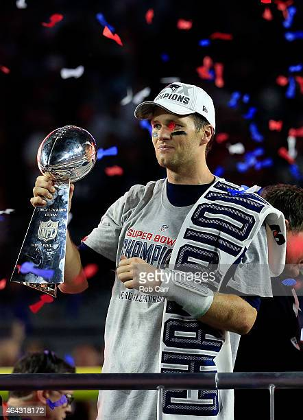 Tom Brady of the New England Patriots celebrates while holding up the Vince Lombardi Trophy after defeating the Seattle Seahawks during Super Bowl...