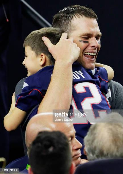 Tom Brady of the New England Patriots celebrates with his son after defeating the Atlanta Falcons 3428 in overtime to win Super Bowl 51 at NRG...
