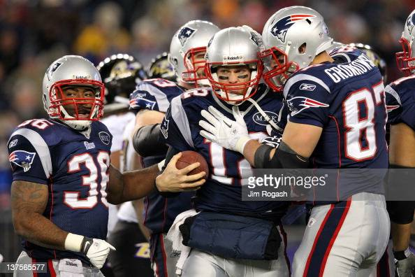 Tom Brady of the New England Patriots celebrates with his teammates after scoring a touchdown in the fourth quarter against the Baltimore Ravens...