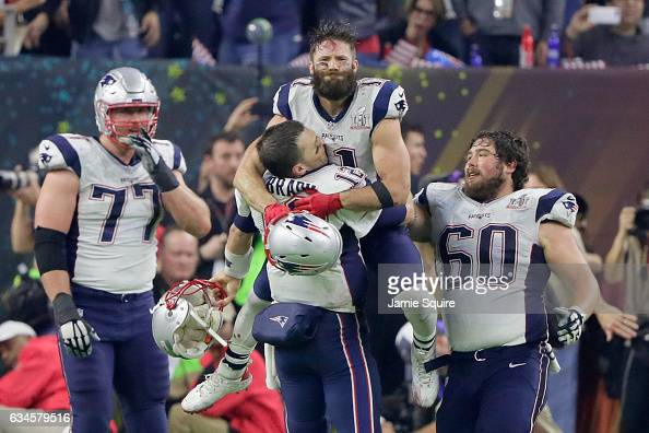 Tom Brady of the New England Patriots celebrates with Julian Edelman after defeating the Atlanta Falcons 3428 in overtime to win Super Bowl 51 at NRG...