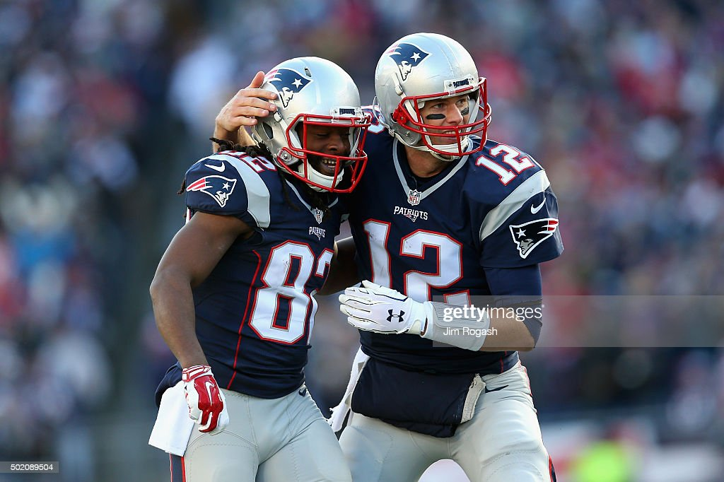 Tom Brady #12 of the New England Patriots celebrates with Keshawn Martin #82 after throwing a touchdown pass to James White #28 (not pictured) during the second quarter against the Tennessee Titans at Gillette Stadium on December 20, 2015 in Foxboro, Massachusetts.