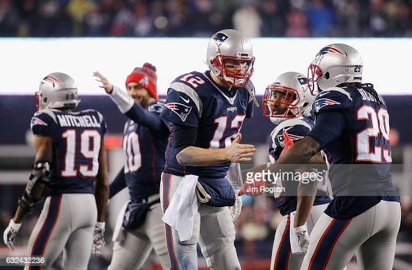 Tom Brady of the New England Patriots celebrates with LeGarrette Blount after throwing a touchdown pass to Julian Edelman during the third quarter...
