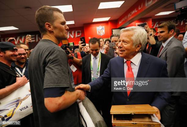 Tom Brady of the New England Patriots celebrates with owner Robert Kraft in the locker room after defeating the Atlanta Falcons during Super Bowl 51...